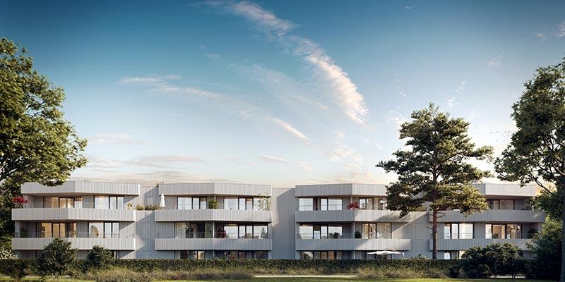 Hell und freundlich wirken die mit KEIM Lignosil-Color beschichteten Mehrfamilienhäuser in Seenähe. Bildquelle: Bauwerk